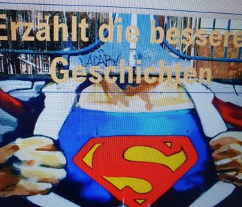 Bild von Superman aus Vortrag von Lena Frischlich mit Aufforderung: Erzählt die besseren Geschichten